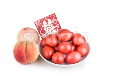 Red color eggs and peach with envelope Chinese word Celebration Stock Photo