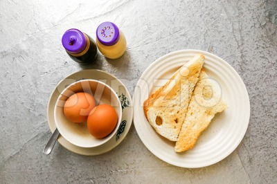 Asian traditional breakfast of half boiled eggs with toast bread Stock Photo