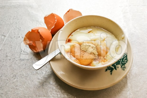 Asian traditional breakfast half boiled eggs with soy sauce pepper Stock Photo