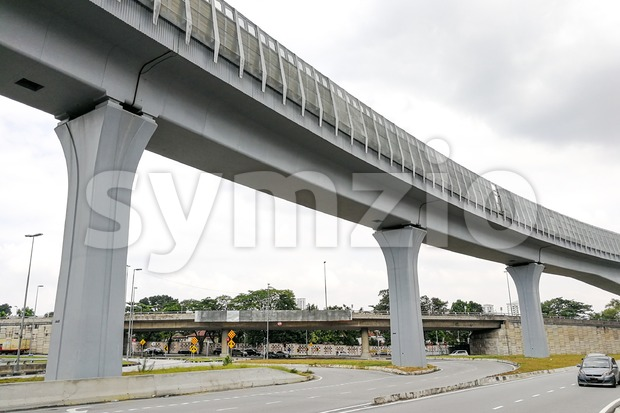 Elevated rail train track with sound barrier wall reduce noise Stock Photo