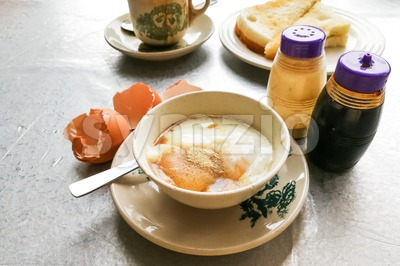 Asian traditional breakfast half boiled eggs, toast bread and coffee Stock Photo