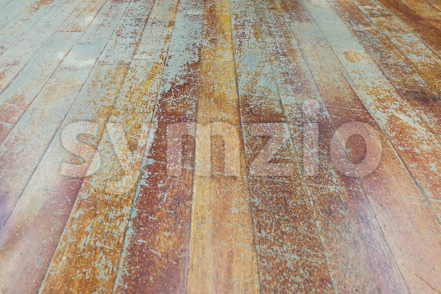 Damaged seasoned wooden floor plank with scratch marks needs restoration Stock Photo