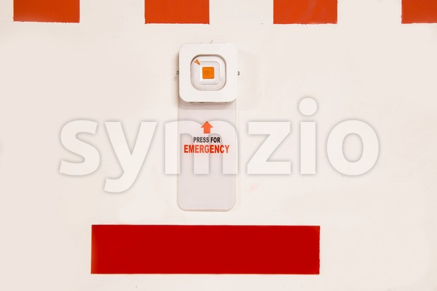 Emergency alarm panic button at car park complex for security Stock Photo