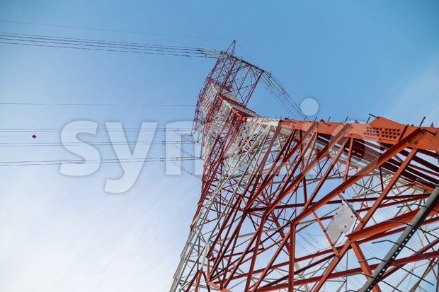 Perspective view under a huge red electricity supply pylon Stock Photo