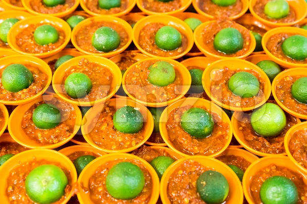 Spicy chili sambal belacan with calamansi lime in mini saucer Stock Photo