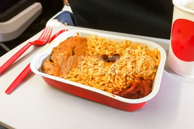 close-up simple in-flight meal rice, meat, coffee in disposable utensils Stock Photo