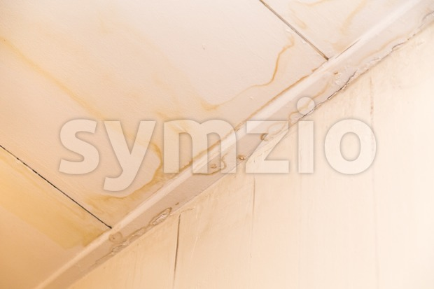Roof leakages results ugly water mark on ceiling Stock Photo
