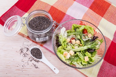 Organic chia seeds with salad healthy meal loaded with antioxidant Stock Photo