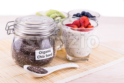 Chia seeds pudding with fresh fruits, healthy nutritious anti-oxidant superfood. Stock Photo