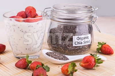 Chia seeds pudding with strawberry fruits, healthy nutritious anti-oxidant superfood. Stock Photo