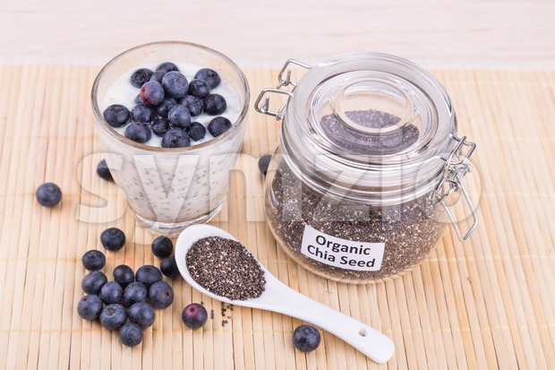 Chia seeds pudding with blueberry fruits, healthy nutritious anti-oxidant superfood. Stock Photo