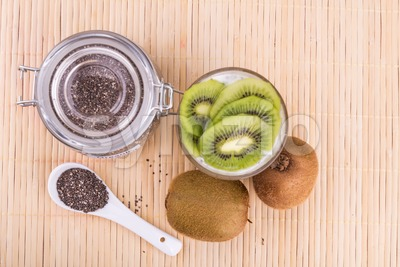 Chia seeds pudding with kiwi fruits, healthy nutritious anti-oxidant superfood. Stock Photo
