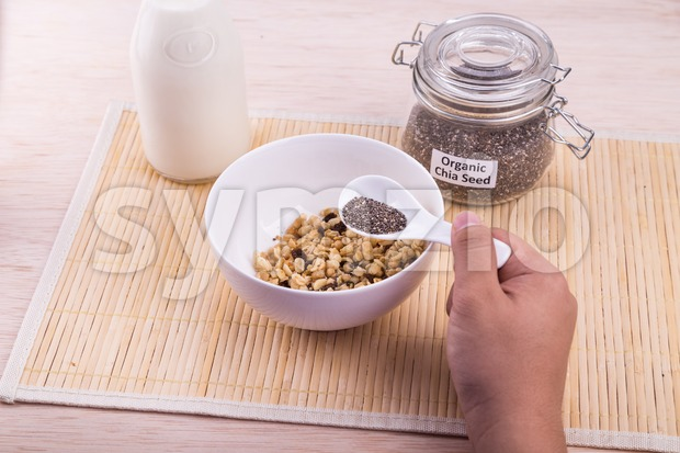 Chia seeds with fresh milk, healthy nutritious anti-oxidant superfood breakfast Stock Photo