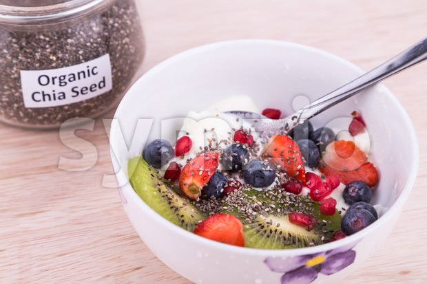 Chia seeds with fresh fruits and yogurt, healthy nutritious anti-oxidant superfood breakfast for whole family