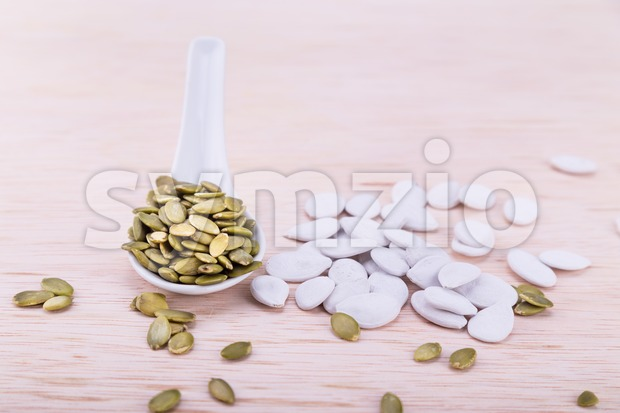 Organic pumpkin seeds healthy snacks good for well-being Stock Photo