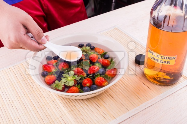 Apple cider vinegar neutralize pesticides found on fruits and vegetable Stock Photo
