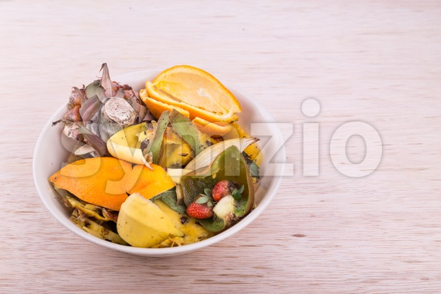 Bowl of household vegetable and fruits refuse collected for compost Stock Photo