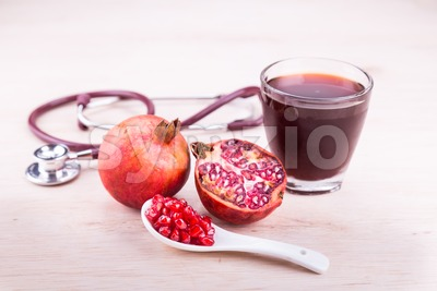 Organic Pomegranate juice with high anti-oxidant good for health Stock Photo