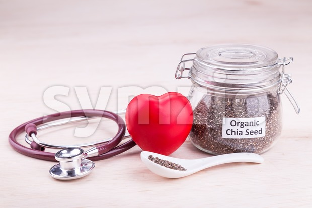 Chia seeds superfood contains healthy omega-3, carbohydrates, protein, fiber, antioxidants. Stock Photo