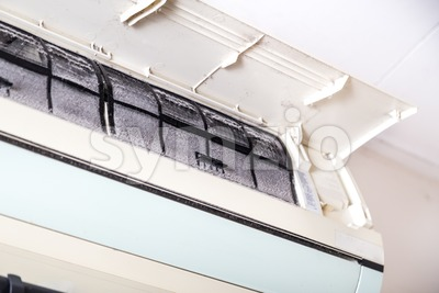 Air conditioner with filter full of unhygienic trapped dust Stock Photo