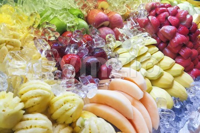 Fresh and refreshing sliced fruits variety neatly arranged Stock Photo