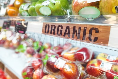 Organic food signage on modern supermarket fresh produce fruits aisle Stock Photo
