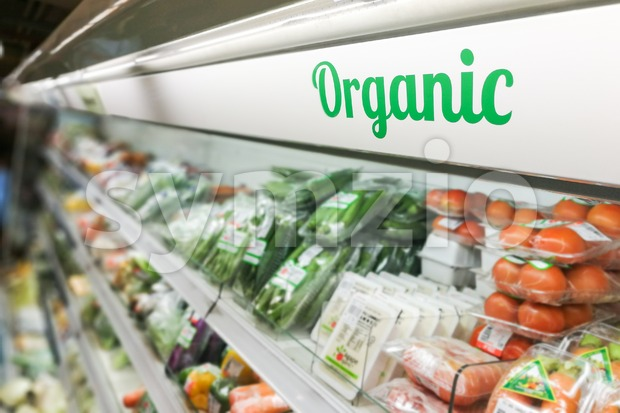 Organic food signage on modern supermarket fresh produce vegetable aisle to appeal to healthy lifestyle shoppers