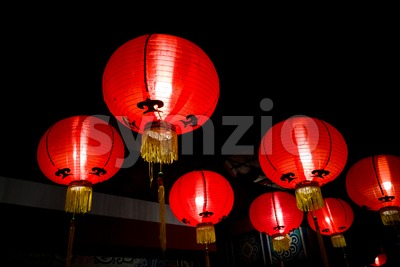 Red lanterns for good luck lit during Chinese New Year Stock Photo
