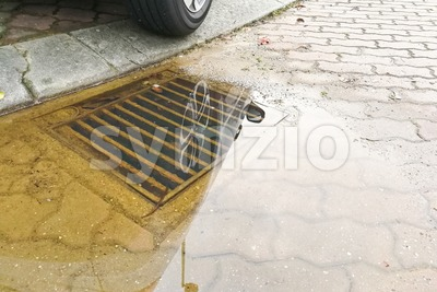 Waterlogged on street due to clogged drainage system Stock Photo