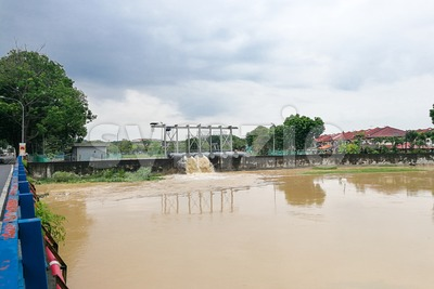 Rain water pumped into river from flood storm retention pond Stock Photo