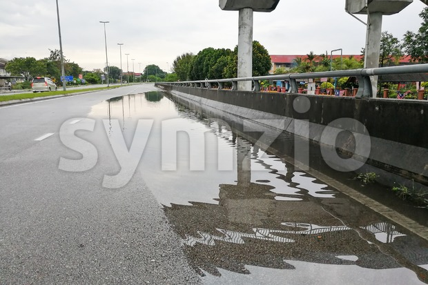 Waterlogged on road after rain due to clogged drainage system