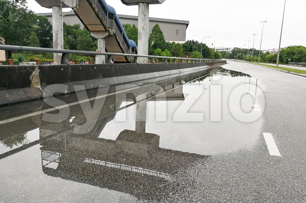 Waterlogged on road due to clogged drainage system Stock Photo
