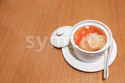 Traditional Chinese sweet dessert of fungus papaya for well-being health Stock Photo