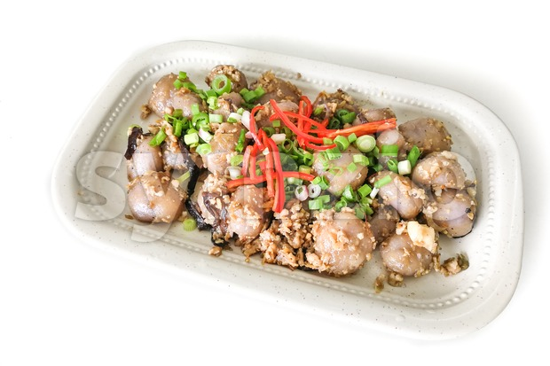Serving of delicious and popular Chinese Hakka dish named abacus seeds or suan pan zhi