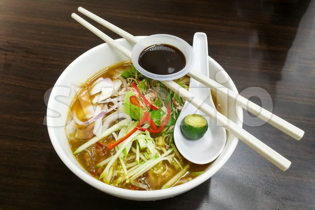 Penang Asam Laksa with prawn paste and lime, popular Malaysian cuisine
