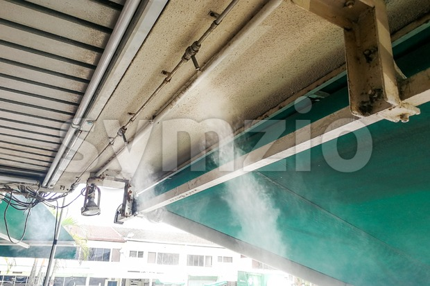 Water mist cooling system on ceiling lowers tropical ambient temperature Stock Photo