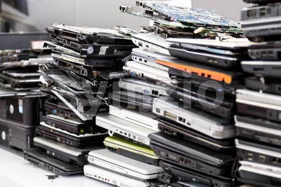 Stack of old, broken and obsolete laptop computer for repair Stock Photo