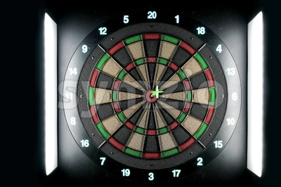Dart pin on board bullseye. Achievement and success concept. Stock Photo