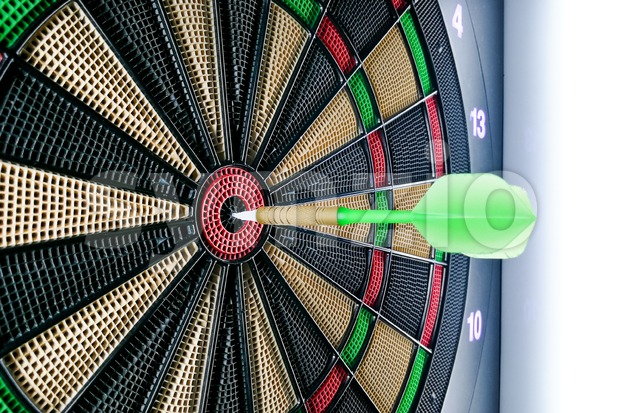 Close-up on dart pin on board bullseye Stock Photo
