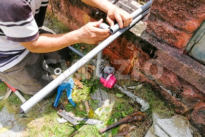 Series of plumber fixing installing oudoor valve meter piping Stock Photo