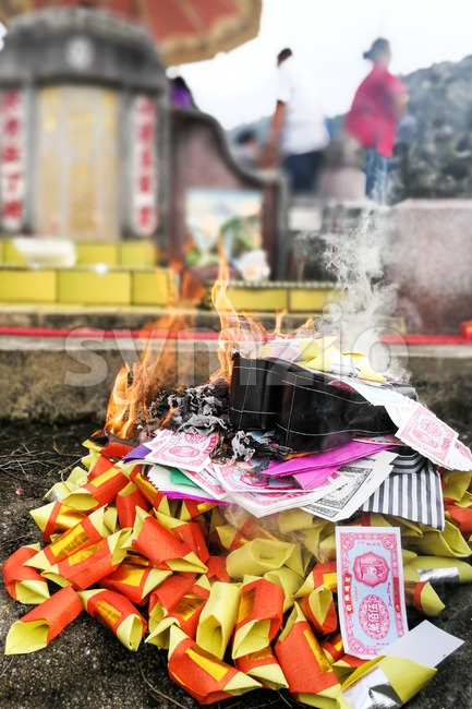 Chinese taoism tradition to burn paper money and gold to ancestors during Qingming or tomb sweeping day