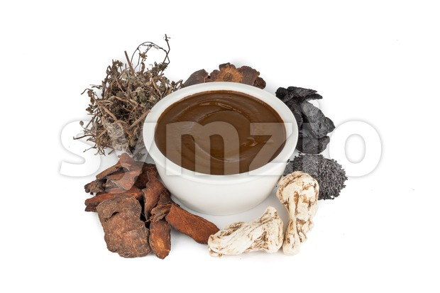 Herbal traditional Chinese medicine preparation for treating hair and scalp on white background