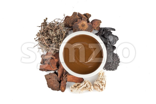 Overhead view of herbal traditional Chinese medicine preparation for treating hair and scalp on white background