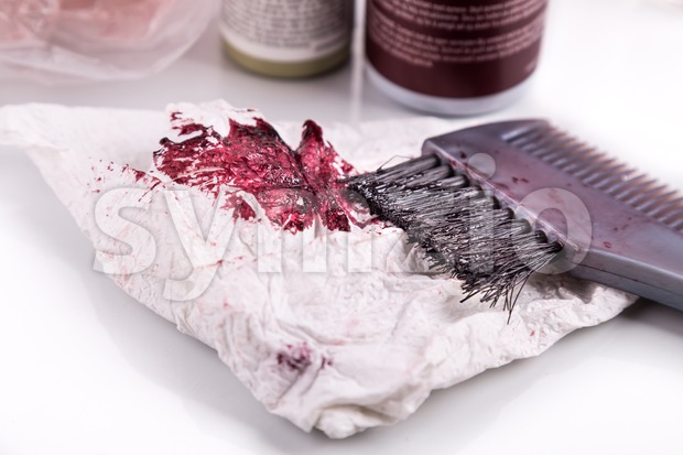 Close-up of chemical hair color dye set with comb and brush