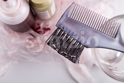 Close-up of chemical hair color dye set with comb brush Stock Photo