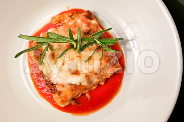 Overhead view of closeup of fine dining italian lasagna Stock Photo