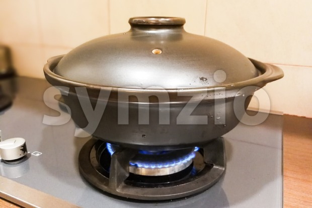 Ceramic clay pot on gas fire generated stove.  Not suitalbe material as clay is porous.