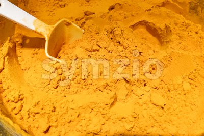 Pile of organic turmeric powder Stock Photo