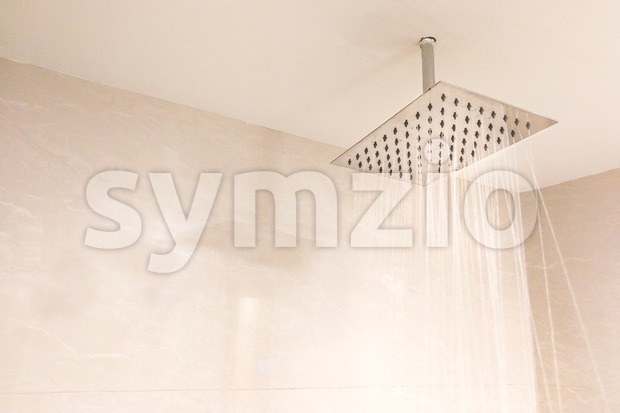 Shower head with refreshing water droplets spray in bathroom for relaxing experience