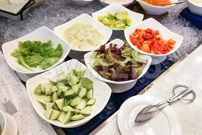 Healthy appetizing vegetable breakfast organic salad, tomato, onion, cucumber, dressing Stock Photo